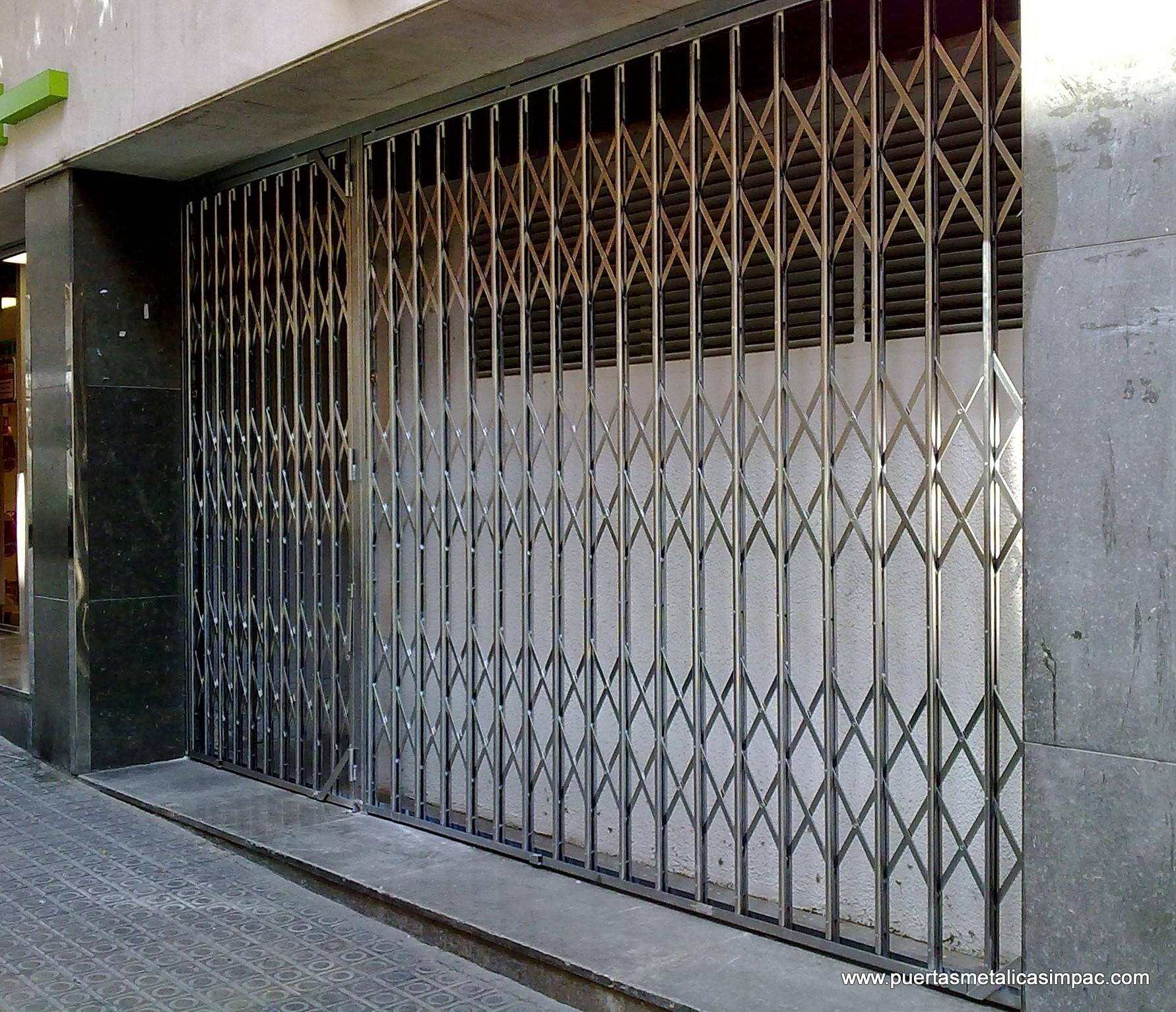 Puerta de ballesta impac puertas met licas - Modelos de puertas metalicas para casas ...